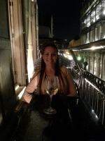Notice my wine and glass are sitting at an angle? I'm leaning towards the building to keep from falling off the balcony!